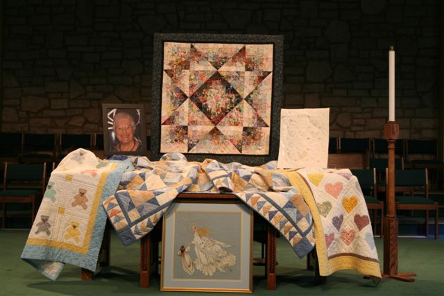 Quilts and needlework by Peggy Straughen.